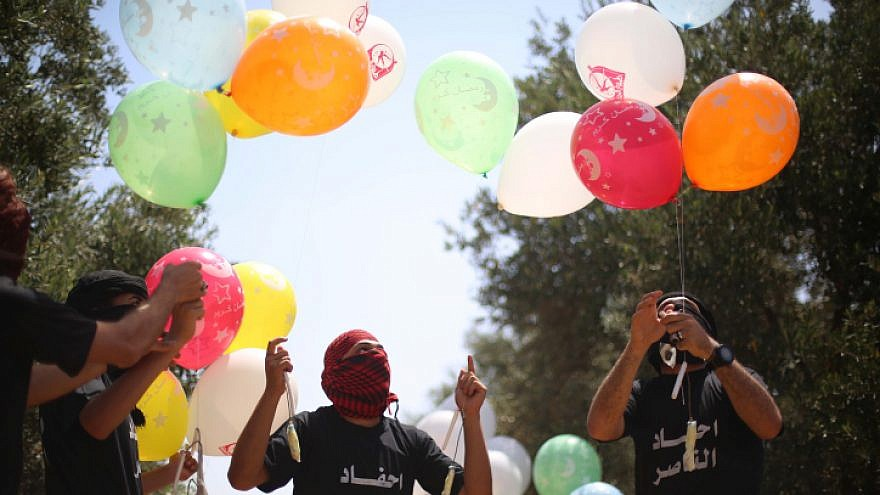 Palestinian youths in the Gaza Strip prepare incendiary balloons with which to attack Israel, May 31, 2019. Photo by Hassan Jedi/Flash90.