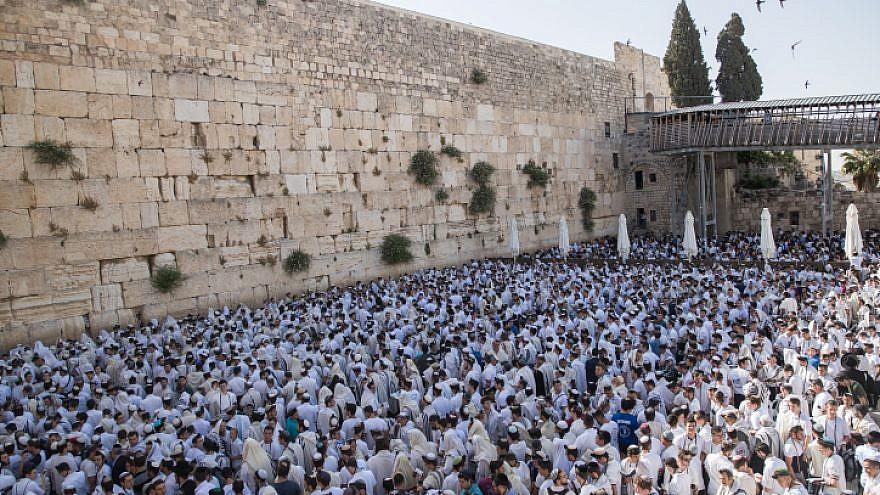 Jewish men pray at the Western Wall in Jerusalem Old City during Yom Yerushalayim (Jerusalem Day), June 2, 2019. Photo by Yonatan Sindel/Flash90