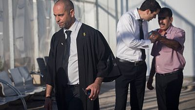 Nashef Darwish (left), the attorney for Mahmoud Katusa, a Palestinian man charged with kidnapping and raping a 7-year-old Israeli girl few months ago, stands outside Israel's Ofer military court on June 19, 2019. Photo by Yonatan Sindel/Flash90.