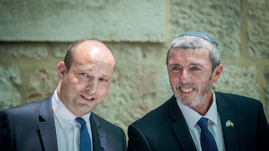 Outgoing Israeli Minister of Education Naftali Bennett speaks with newly appointed Education Minister Rafi Peretz during an exchange ceremony of ministers, held in Jerusalem on June 26, 2019. Photo by Yonatan Sindel/Flash90.
