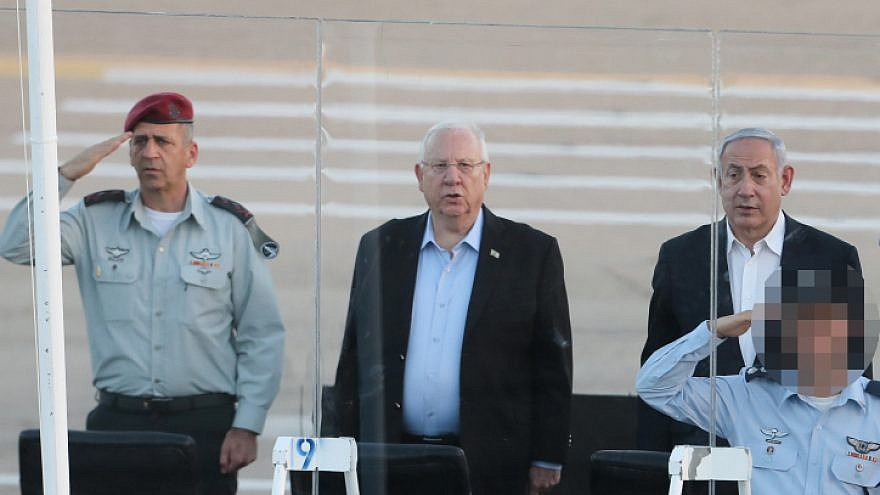 Israel Defense Forces' Chief of Staff Aviv Kochavi (left), Israeli President Reuven Rivlin (center) and Israeli Prime Minister Benjamin Netanyahu at a graduation ceremony for soldiers who have completed the IAF Flight Course at the Hatzerim Air Base, June 27, 2019. Photo by Flash90.