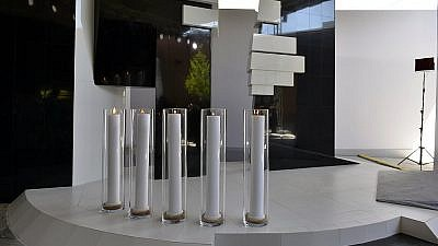Five glass flasks with candles are installed at the monument. Credit: Jewish Museum and Tolerance Center.