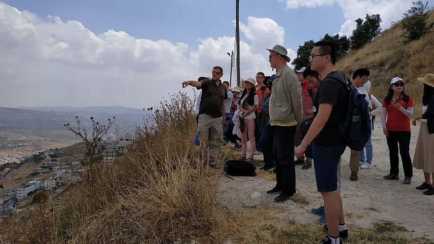 "Chinese students take a tour of Mount Kabir in Samaria on June 13, 2019, as part of a program run by Im Tirtzu, geared at turning visiting students into ""ambassadors for Israel"" upon their return to China. Photo: Dov Trachtman."