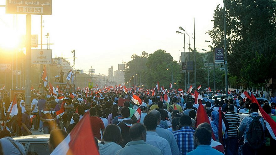 A protest march in Cairo against Egyptian President Mohamed Morsi, June 28 2013. Credit: Lilian Wagdy via Wikimedia Commons.