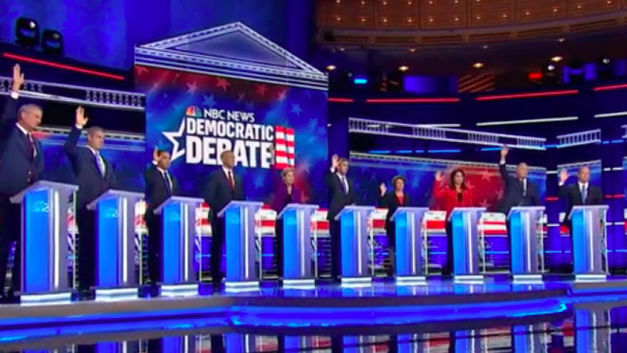 "During the first Democratic presidential primary debate on June 26, 2019, when asked by moderator and ""NBC Nightly News"" anchor Lester Holt who, if elected, would re-enter the United States in the 2015 Iran nuclear deal, all but New Jersey Sen. Cory Booker raised a hand. Credit: Screenshot."