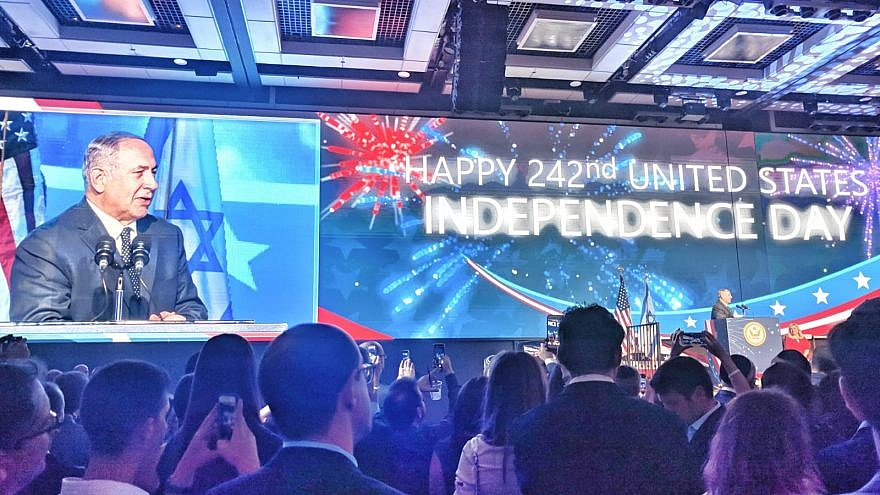 Israeli Prime Minister Benjamin Netanyahu addresses guests at the official 242nd U.S. Independence Day celebration at Airport City in Lod on July 3, 2018. Photo: Yishai Fleisher.
