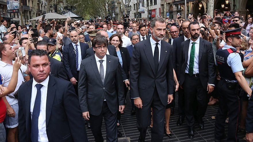 King Felipe VI of Spain (center), accompanied by Catalonia President Carles Puigdemont (left) and Barcelona Mayor Ada Colau, prepare to lay a wreath at the site of a truck-ramming attack two days earlier on La Rambla that left two people dead and more than 100 wounded, Aug. 19, 2017. Credit: Wikimedia Commons.