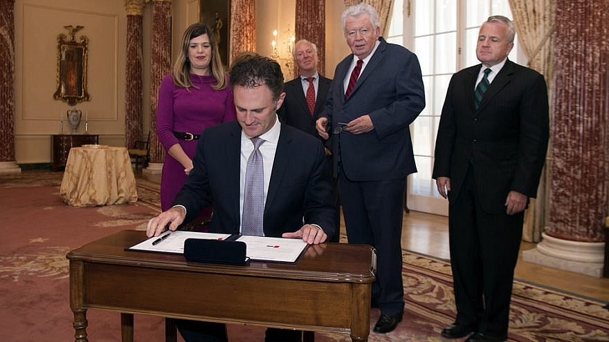 Nathan Sales signs his appointment papers to become ambassador at large and coordinator for counterterrorism at the U.S. Department of State in Washington, D.C., Sept. 29, 2017. Credit: State Department Photo.