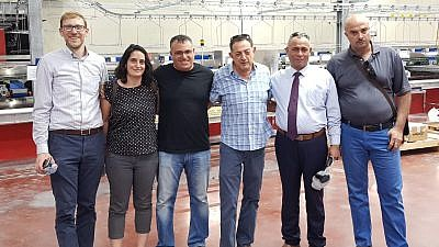 Members of a joint Israeli-Palestinian delegation that toured the Dead Sea region on July 9, 2019. Credit: Judea-Samaria Chamber of Commerce and Industry.