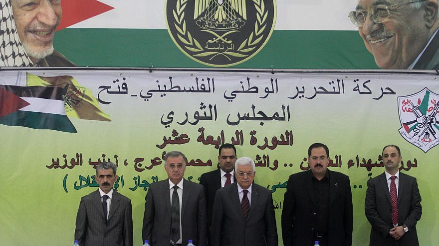 Palestinian leader Mahmoud Abbas (center) delivers a statement at a conference in Ramallah on Oct. 18, 2014. Photo by Flash90.