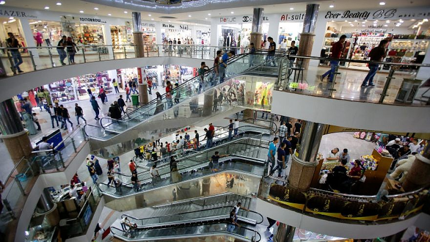 Palestinians shop at a mall in the West Bank city of Hebron on July 5, 2016. Photo by Wisam Hashlamoun/Flash90.
