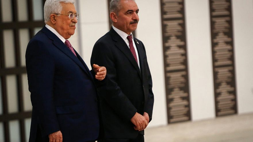 P.A. Prime Minister Mohammad Shtayyeh (right) and P.A. leader Mahmoud Abbas at the swearing-in ceremony of the new government at the P.A. headquarters in Ramallah, April 13, 2019. Photo by Nasser Ishtayeh/Flash90.