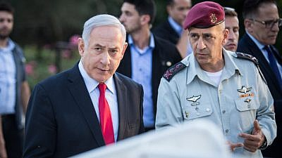 Israeli Prime Minister Benjamin Netanyahu (left) speaks with Israel Defense Forces' Chief of Staff Aviv Kochavi during an event honoring outstanding IDF reservists, at the President's Residence in Jerusalem on July 1, 2019. Photo by Hadas Parush/Flash90.