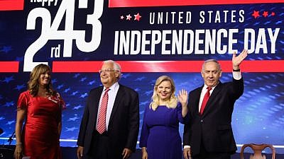 Israeli Prime Minister Benjamin Netanyahu and his wife, Sara, stand next to U.S. Ambassador to Israel David Friedman and his wife, Tammy, at a U.S. Independence Day celebration in Jerusalem on July 2, 2019. Photo by Marc Israel Sellem/POOL.