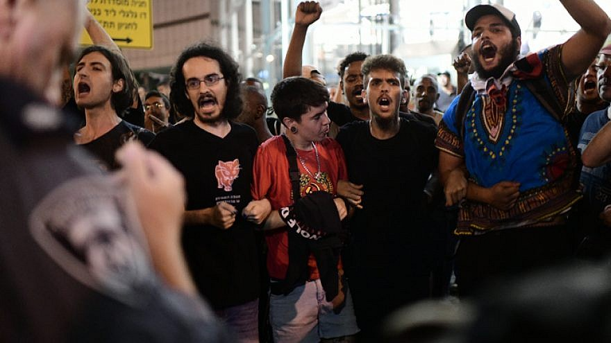 Ethiopian Israelis and supporters take part in a protest in Tel Aviv against the use of police violence after the shooting of Ethiopian teenager Solomon Tekah on July 3, 2019. Photo by Tomer Neuberg/Flash90.