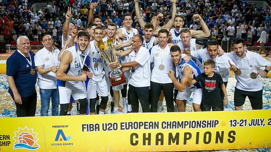 Players of the Israeli national under-20 basketball team celebrate with the trophy after beating Spain at the final of the FIBA U-20 Euro Championship in Tel Aviv on July 21, 2019. Photo by Roy Alima/Flash90.