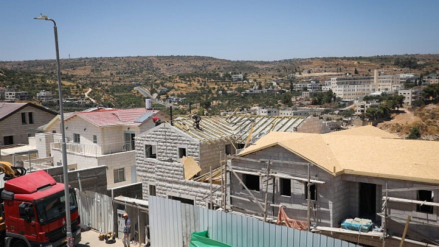 Construction work in the Dagan neighborhood of Efrat in Judea and Samaria on July 22, 2019. Photo by Gershon Elinson/Flash90.