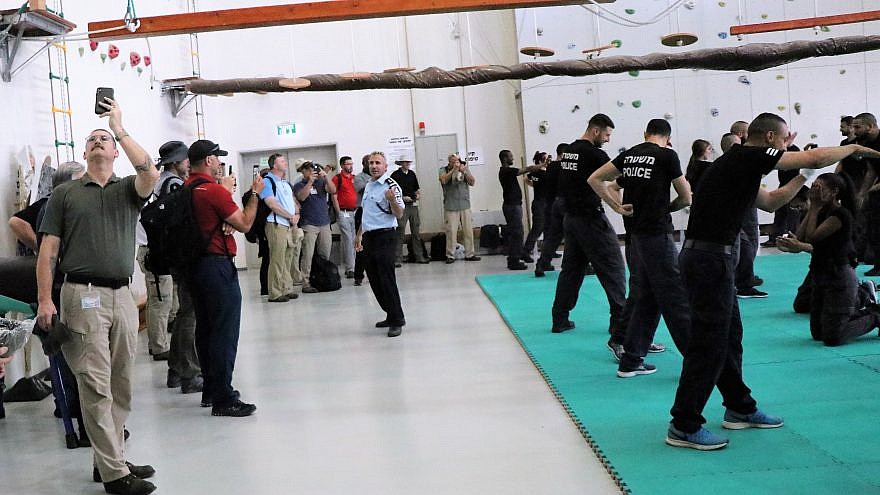 Delegates from the Georgia International Law Enforcement Exchange (GILEE) 27th annual peer-to-peer training program in partnership with Israel witness a police training. Credit: GILLEE.
