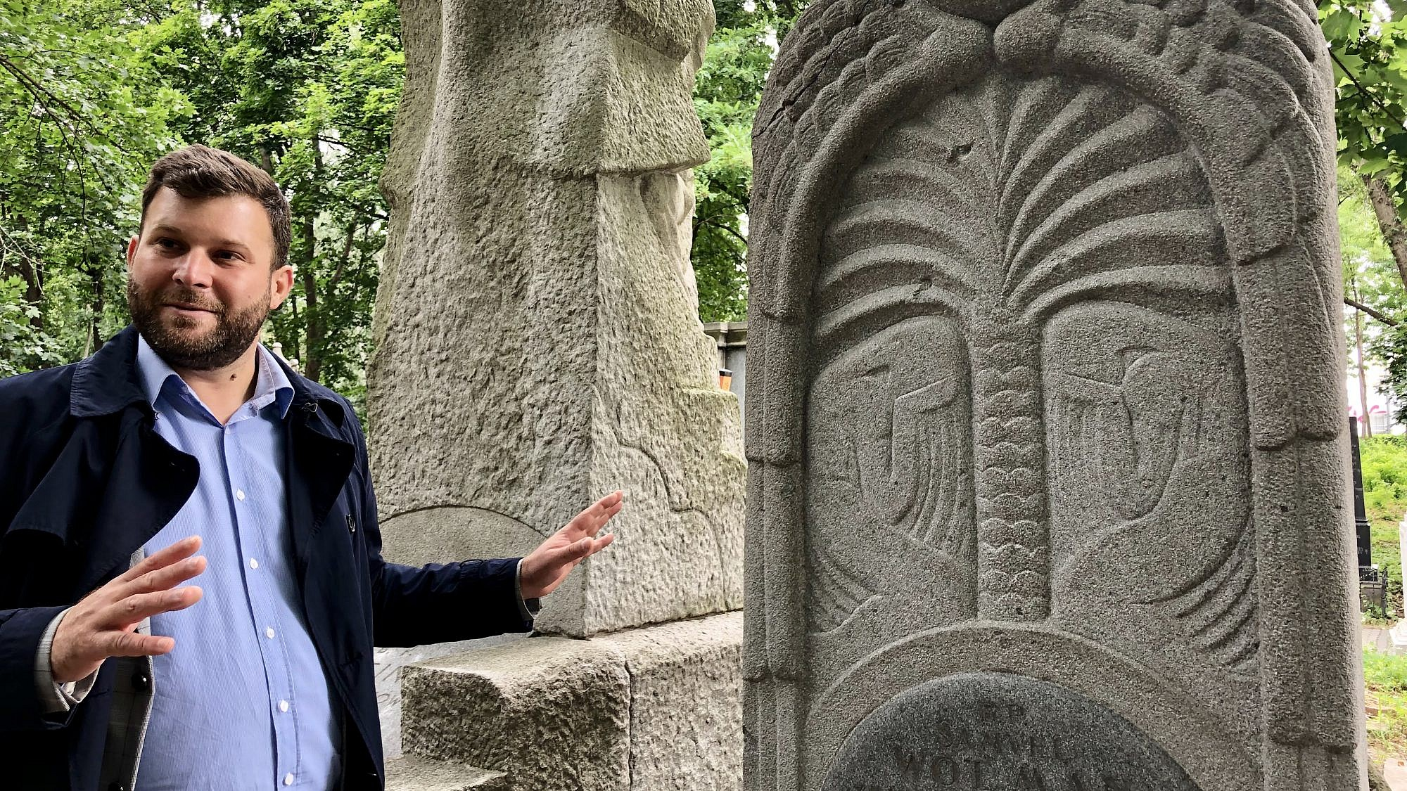 Michał Laszczkowski, CEO of Poland's Cultural Heritage Foundation, gives a tour of the Jewish cemetery in Warsaw, July 2019. Photo by Eliana Rudee.
