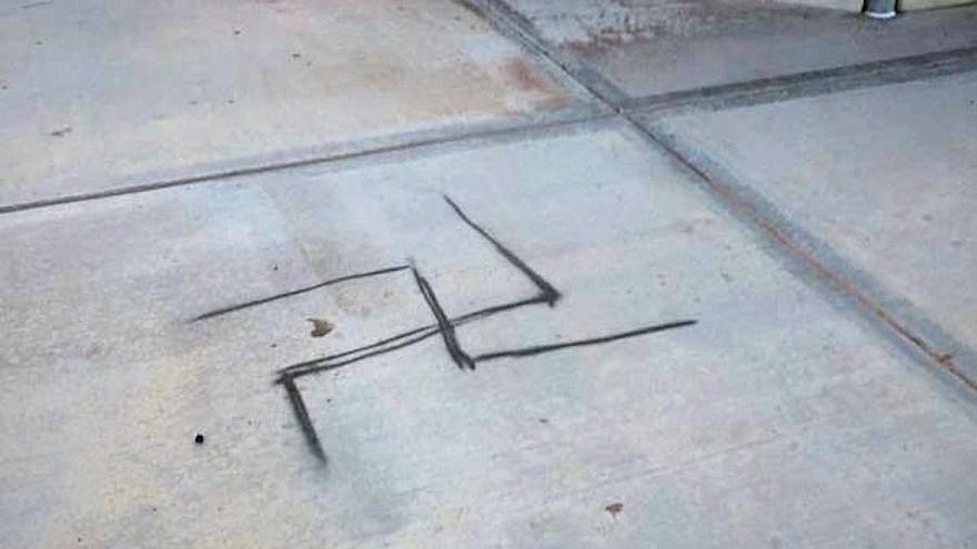 A spray-painted swastika was discovered on the concrete next to a baseball field at Dos Vientos Community Park in Conejo Valley, Calif., in 2019 Photo courtesy of the Anti-Defamation League Santa Barbara/Tri-Counties.