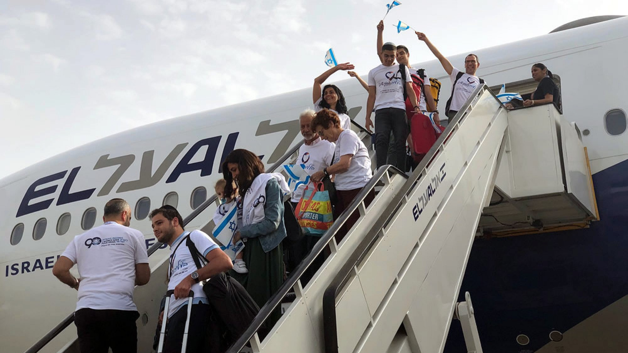"""More than 200 new immigrants (olim) from France, Brazil, Argentina, Venezuela and Russia kick off the """"season of aliyah,"""" in which thousands of new immigrants from all over the world arrive in Israel during the summer months, July 17, 2019. Photo by Eliana Rudee."""