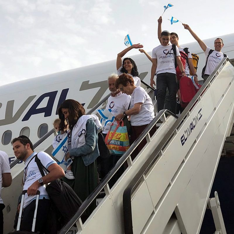 "More than 200 new immigrants (olim) from France, Brazil, Argentina, Venezuela and Russia kick off the ""season of aliyah,"" in which thousands of new immigrants from all over the world arrive in Israel during the summer months, July 17, 2019. Photo by Eliana Rudee."