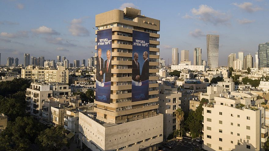 Election campaign posters on Likud Party headquarters in central Tel Aviv show Israeli Prime Minister Benjamin Netanyahu shaking hands with Russian President Vladimir Putin and U.S. President Donald Trump; others show Netanyahu and Prime Minister of India Narendra Modi, July 28, 2019. Photo by Adam Shouldman/Flash90.