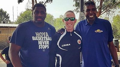 Former pro-basketball players and friends Mike Sweetney (left) and Tamir Goodman (center) at basketball camp in Israel. Credit: Courtesy.