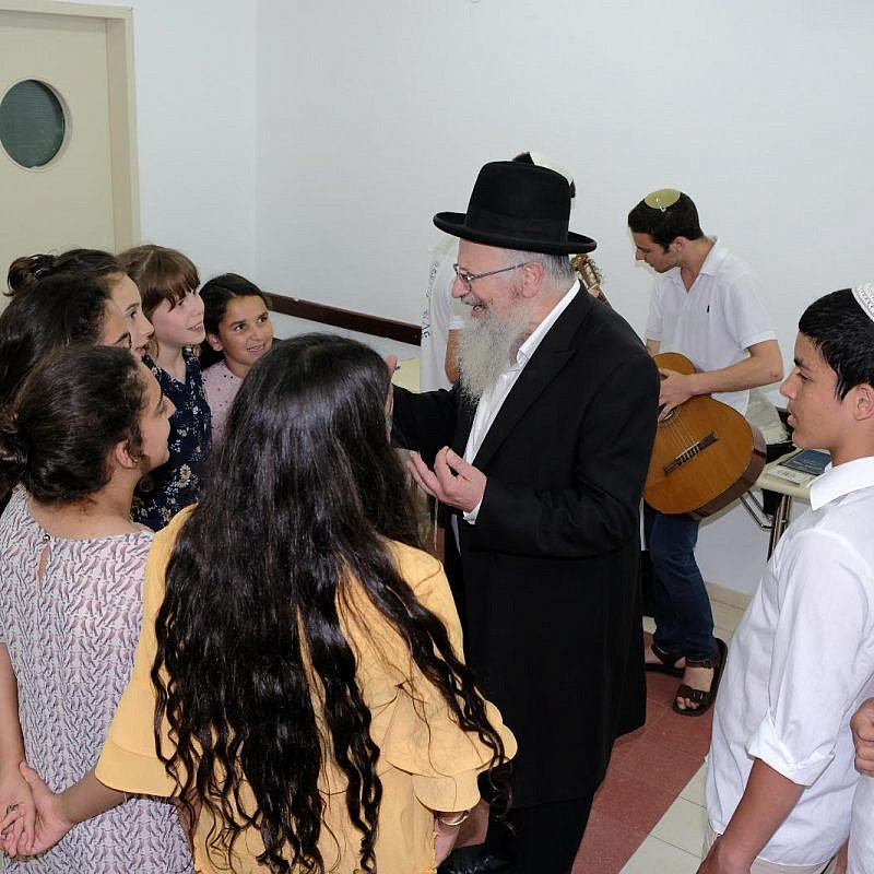 Tzfat Chief Rabbi Shmuel Eliyahu enjoys pre-Shabbat preparation acivities with young campers at the OneFamily Sleepaway camp in northern Israel in July 2019. Photo: Eytan Morgenstern.