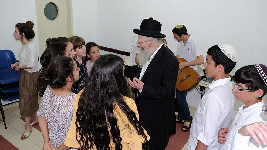 Tzfat Chief Rabbi Shmuel Eliyahu enjoys pre-Shabbat activities at the OneFamily Sleepaway camp in northern Israel in July 2019. Photo by Eytan Morgenstern.