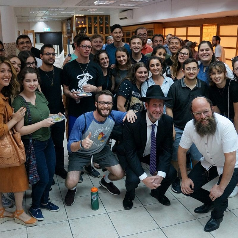 Among the young people who turned out in Jerusalem on July 8, 2019, to celebrate the Lubavitcher Rebbe on his 25th yahrtzeit was London's Rabbi Yitzchak Schochet (first row, second from right), who came to inspire the crowd. Photo by Shoshana Reiter Halpern.