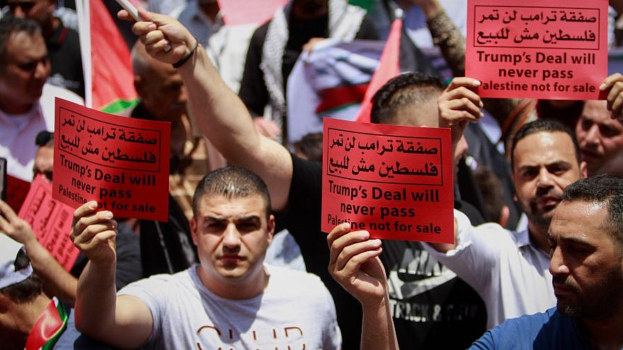 "Palestinian demonstrators protest against U.S. President Donald Trump's Middle East peace plan, and the ""Peace to Prosperity"" conference in Bahrain, in the West Bank city of Nablus on June 25, 2019."