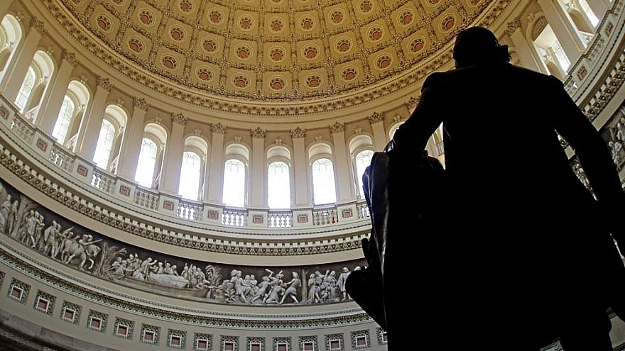 The interior of the U.S. Capitol rotunda, taken from behind the statue of George Washington. Credit: Wikimedia Commons.