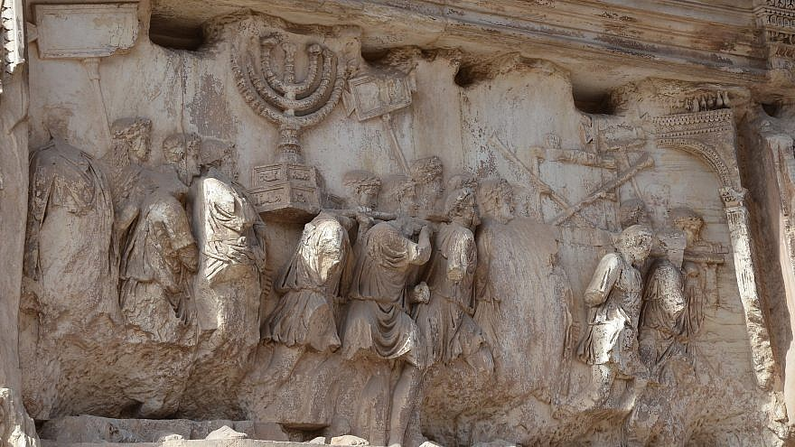 The Arch of Titus in Rome. The arch contains panels depicting the triumphal procession celebrated in 71 C.E. after the Roman victory culminating in the fall of Jerusalem, which is mourned on the Jewish holiday of Tisha B'Av. Credit: Flickr.