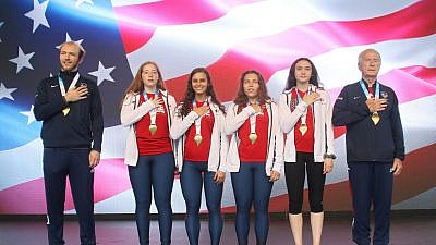 Athletes from the Team USA delegation stand for the national anthem at the 2019 Maccabi Games medal ceremony in Budapest, Hungary. Credit: Macaabi Games via Facebook.
