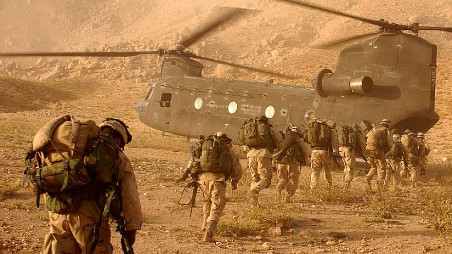 U.S. soldiers on the way back to Kandahar Army Air Field on Sept. 4, 2003. The soldiers were searching for Taliban fighters and illegal weapons caches. U.S. Army Photo by Staff Sgt. Kyle Davis.