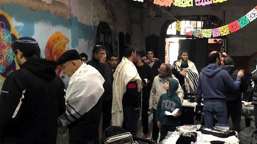 Praying for the first time in decades in one of Argentina's oldest synagogues, August 2019. Credit: Chabad.org/News.