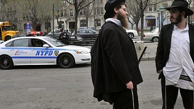 Orthodox Jewish men in the Crown Heights neighborhood of Brooklyn, N.Y. Photo by Serge Attal/Flash90.
