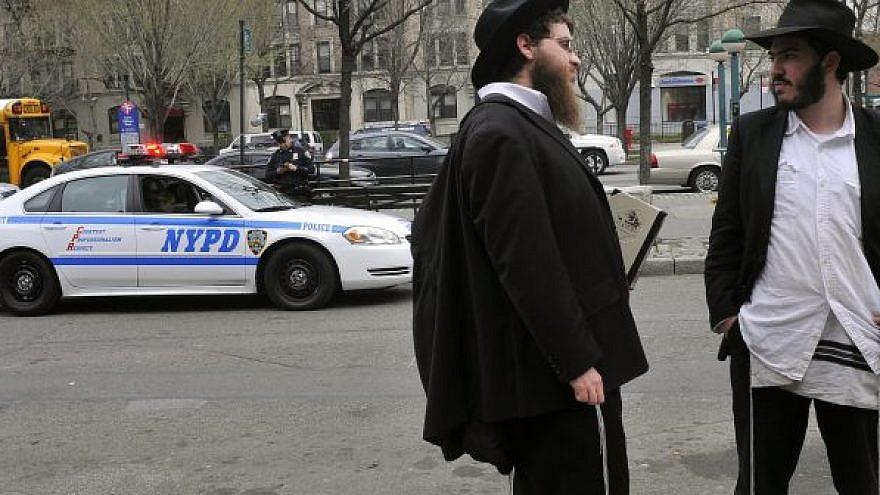 Orthodox Jewish men in the Crown Heights neighborhood of Brooklyn, N.Y. Photo: Serge Attal/Flash90.