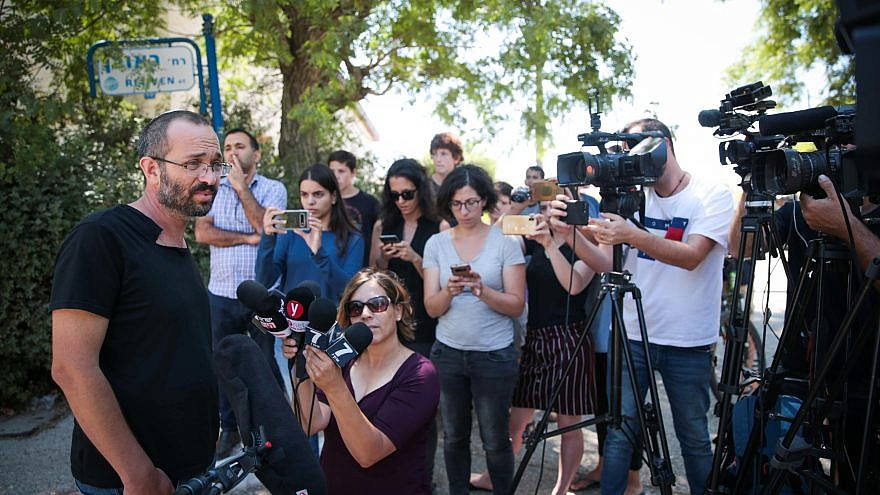 Yoav Sorek, the father of Dvir Sorek, the yeshivah student and IDF recruit who was found stabbed to death near the Jewish settlement of Migdal Oz in Gush Etzion, speaks with the media outside the family home in Ofra on Aug. 9, 2019. Photo by Flash90.
