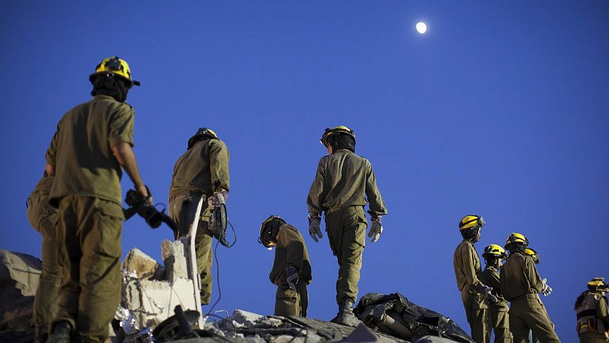 Israeli Home Front Command soldiers take part in a defense drill simulating a building collapse following a chemical missile attack in the city of Jerusalem on Aug. 27, 2012. Photo by Yonatan Sindel/Flash90.