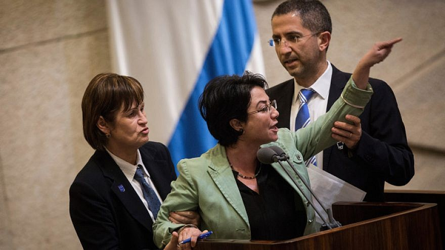 Knesset member Hanin Zoabi is removed by Knesset security during her speech at a plenum session before a vote on a bill requiring left-wing foundations and organizations to reveal their sources of funding, on Feb. 8, 2016. Photo by Hadas Parush/Flash90.