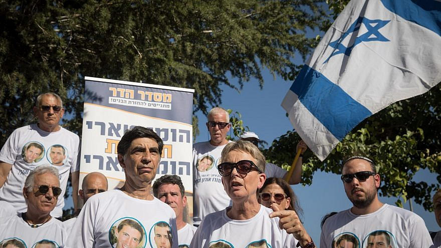 Bereaved parents of Hadar Goldin and other family members and supporters gather outside the state memorial ceremony for Operation Protective Edge at Mount Herzl, calling for the return of the missing soldiers Harad Goldina and Oron Shaul who were killed and taken by Hamas in the operation 5 years ago. Credit: Noam Revkin Fenton/Flash90
