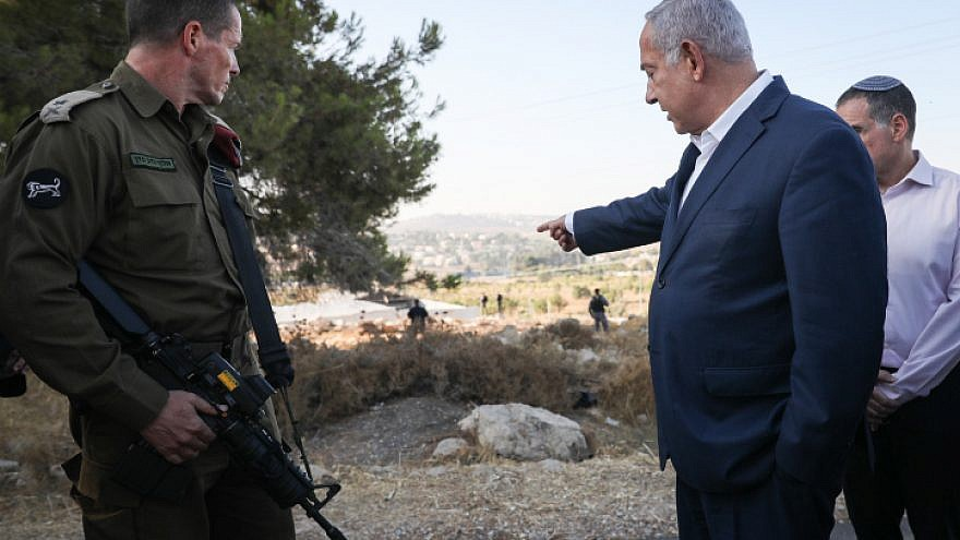 Israeli Prime Minister Benjamin Netanyahu visits the location where yeshivah student Dvir Sorek's body was found near Migdal Oz in Gush Etzion on Aug. 8, 2019. Photo by Noam Revkin Fenton/Flash90.