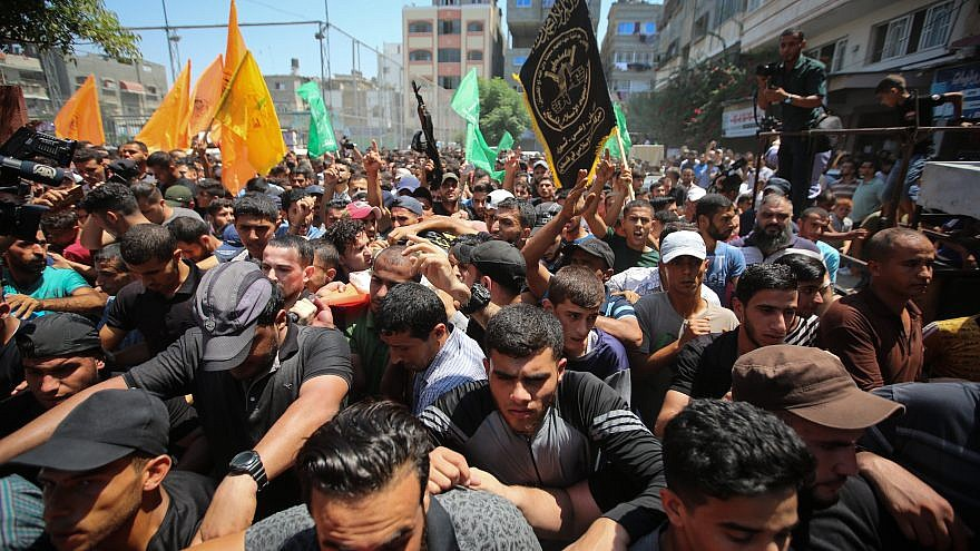Mourners carry the body of Palestinian gunman Mohamad Al-Tramsi during his funeral in the Gaza Strip on Aug. 18, 2019. Al-Tramsi was killed along with two other Palestinians by IDF shelling in response to an infiltration attempt into Israel. Credit: Hassan Jedi/Flash90.