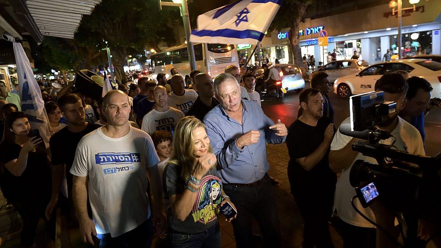 Benny Gantz (center), head of Blue and White Party, mingles with young supporters at a bar on Dizengoff Street in Tel Aviv as part of his election campaign efforts, Aug. 22, 2019. Photo by Gili Yaari/Flash90.