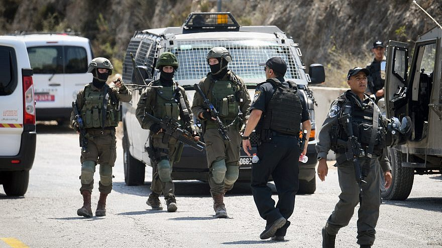 Israeli soldiers and security forces at the scene of a terror attack near Danny Spring, or Ein Bubin, in the West Bank, on Aug. 23, 2019. A father and his two children were seriously injured when a grenade or improvised explosive device was thrown at them. Photo by Flash90.