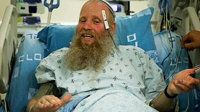 Rabbi Eitan Shnerb speaks to the media at the Hadassah Ein Kerem Hospital, a day after being wounded in a terrorist bombing while hiking that killed his 17-year-old daughter Rina and wounded his 19-year-old son Dvir, on Aug. 24, 2019. Photo by Flash90.