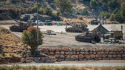 Israeli soldiers with their artillery unit near the Israel-Syria border in the Golan Heights on Aug. 25, 2019. Photo by Basel Awidat/Flash90.