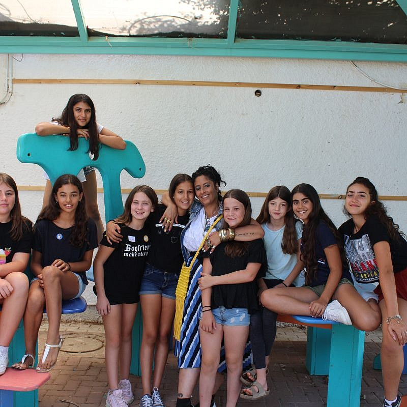 A group of 12-year-olds at the Yuvalei Ha-Bsor School summer camp with their senior adult educator (center) Limor Or, July 2019. Photo by Eric Narrow/JNF.